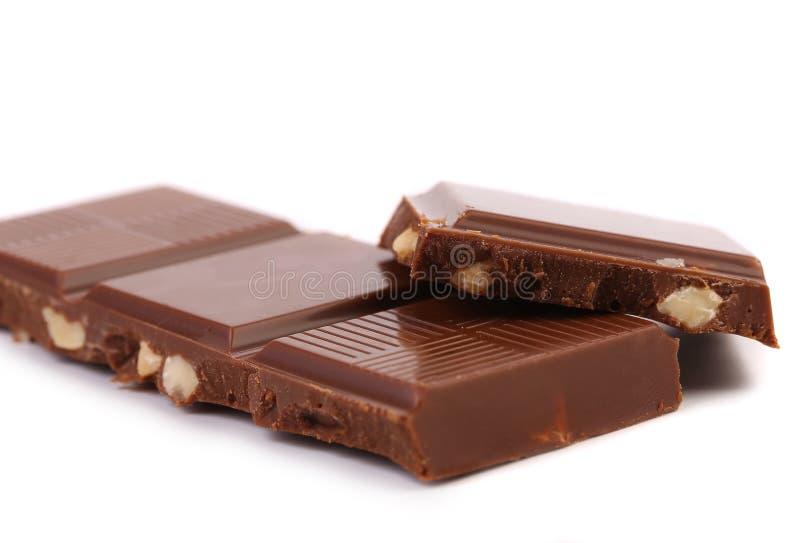 Vier stukken van chocolade stock foto's