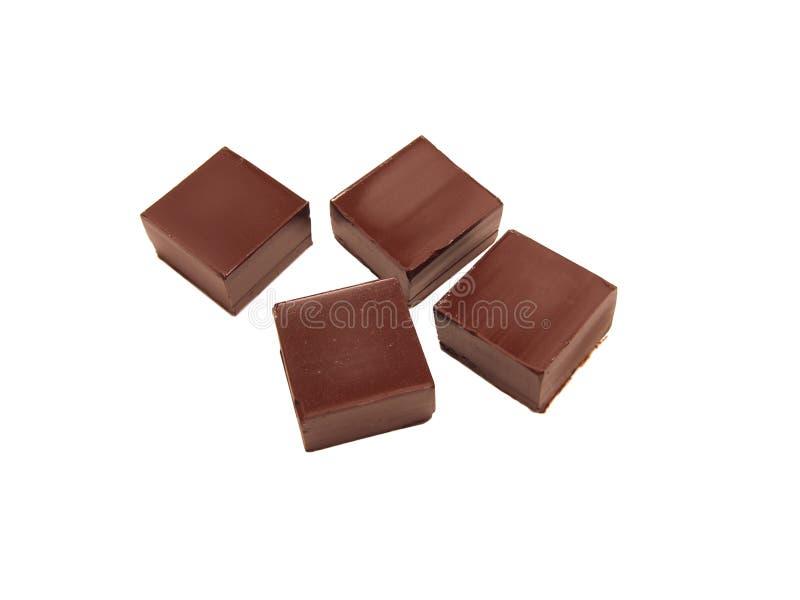 Vier stukken van donkere chocolade stock foto