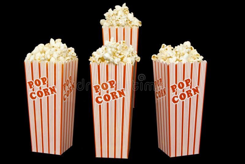 Vier Theater-Kästen frisches Popcorn stockfotos