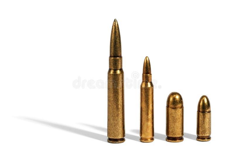 Vier verschillende kogels op wit royalty-vrije stock afbeeldingen