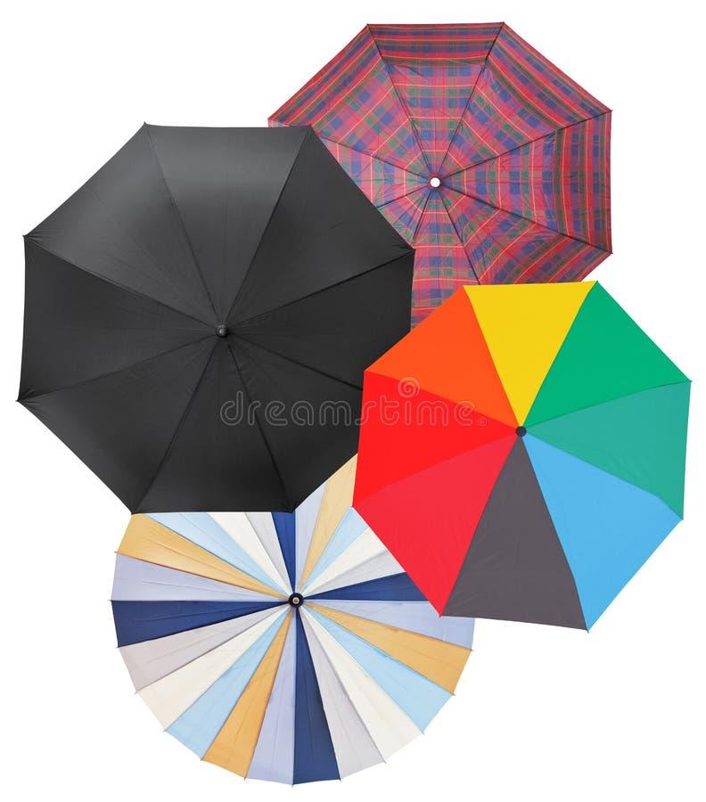 Vier verschillende open die paraplu's op wit worden geïsoleerd royalty-vrije stock foto