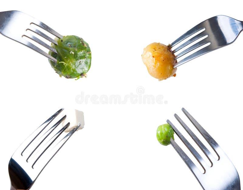 Vier vorken met maaltijd stock fotografie