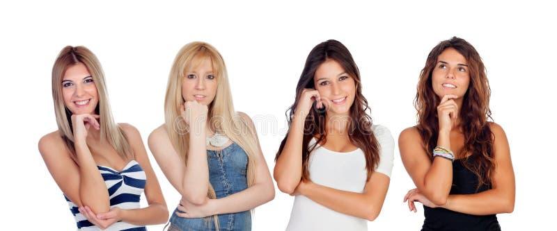 Vier vrij het jonge vrouwen denken stock afbeeldingen