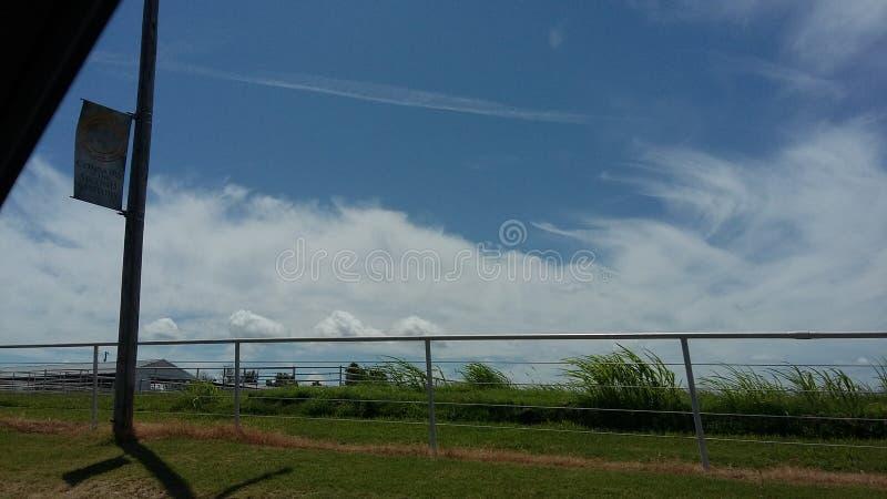Vier Wolken in Folge lizenzfreies stockbild