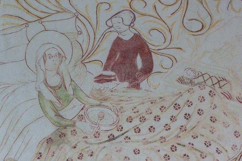 Vierge Marie dans le lit après la naissance, mangeant du gruau photos stock