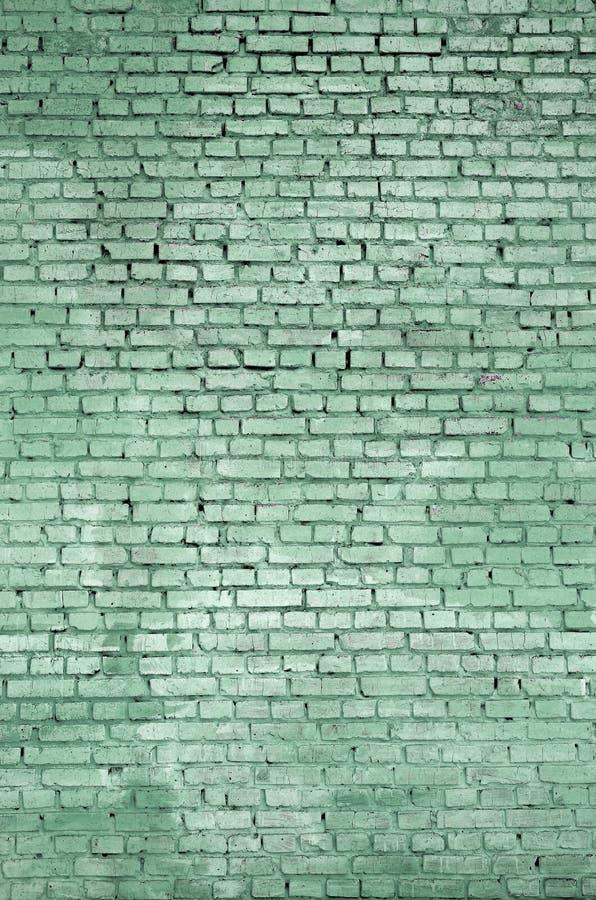 Vierkante de muurachtergrond en textuur van het baksteenblok Geschilderd in groen royalty-vrije stock foto's