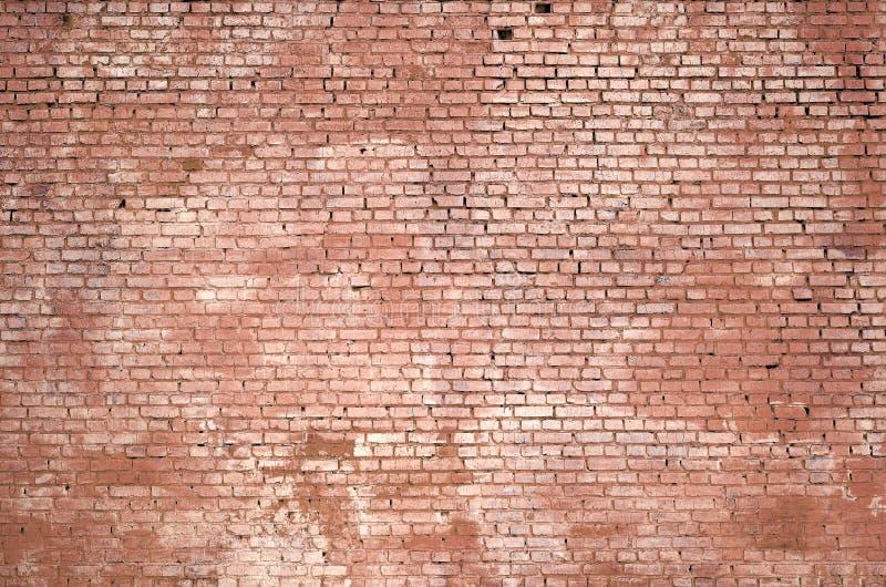 Vierkante de muurachtergrond en textuur van het baksteenblok Geschilderd in rood royalty-vrije stock afbeeldingen