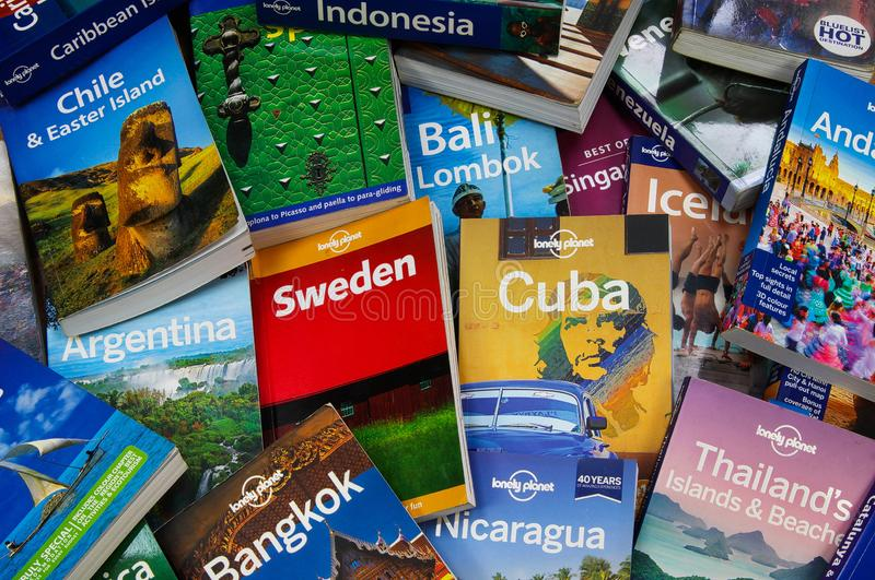 Travel around the world - View on pile of lonely planet travel guide books from different stock photography