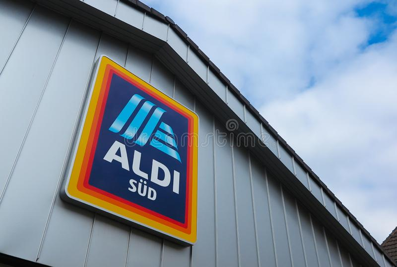 VIERSEN, GERMANY - MARCH 27. 2019: View in isolated ALDI logo under the roof of grey metal wall stock images