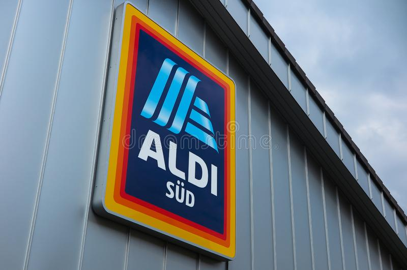 VIERSEN, GERMANY - MARCH 27. 2019: View in isolated ALDI logo under the roof of grey metal wall royalty free stock images