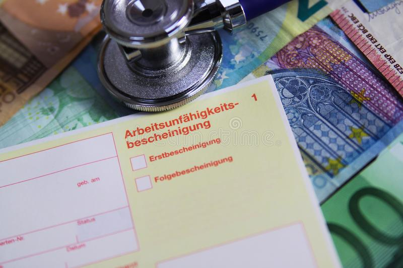 VIERSEN, GERMANY - MAY 20. 2019: Inability to work cost concept - Stethoscope and yellow certificate of incapicity German: stock photos