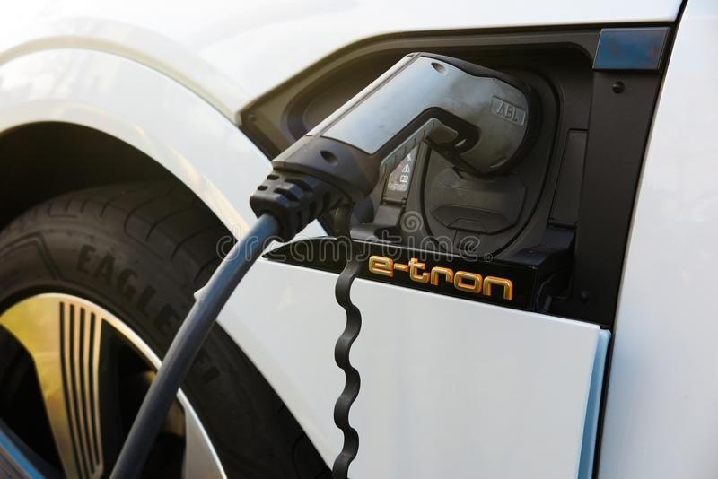 Close up of isolated plug connector charging battery of electric car Audi e-tronic royalty free stock photo