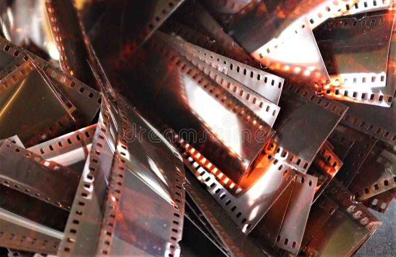 VIERSEN, GERMANY - SEPTEMBER 30. 2018: Close up of illuminated shining retro vintage film strips royalty free stock photo