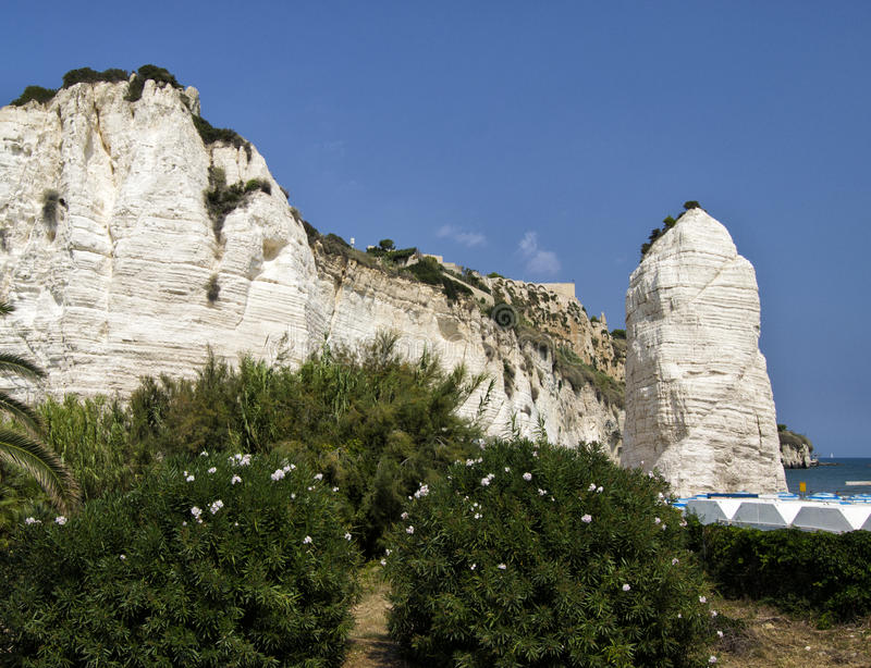 Vieste, Gargano, Apulia, Italy. Pizzomunno calcareous white rock in a sunny day in summer stock images