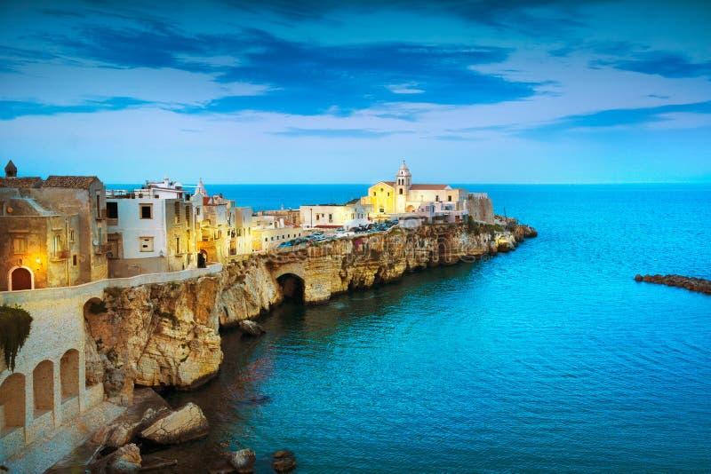 Vieste town on the rocks, Gargano, Apulia, Italy. Vieste town on the rocks, Gargano peninsula, Apulia, southern Italy, Europe stock image