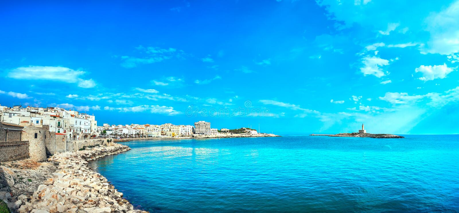Vieste town on the rocks and the lighthouse, Gargano, Apulia, It. Vieste town on the rocks and the lighthouse, Gargano peninsula, Apulia, southern Italy, Europe royalty free stock photo