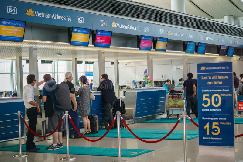 Vietnam Airlines check-in counter, Tan Son Nhat Airport, Saigon, Vietnam. royalty free stock image