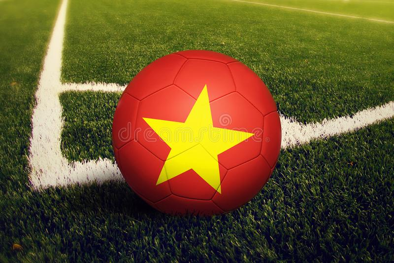 Vietnam ball on corner kick position, soccer field background. National football theme on green grass vector illustration