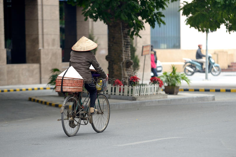 Vietnam bicycle. A woman cycles on her bicycle in Vietnam, motion blur stock images
