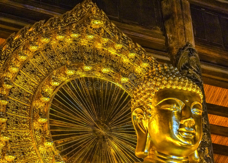Vietnam Chua Bai Dinh Pagoda: Close up of face Giant Golden Buddha statue in temple. royalty free stock photo