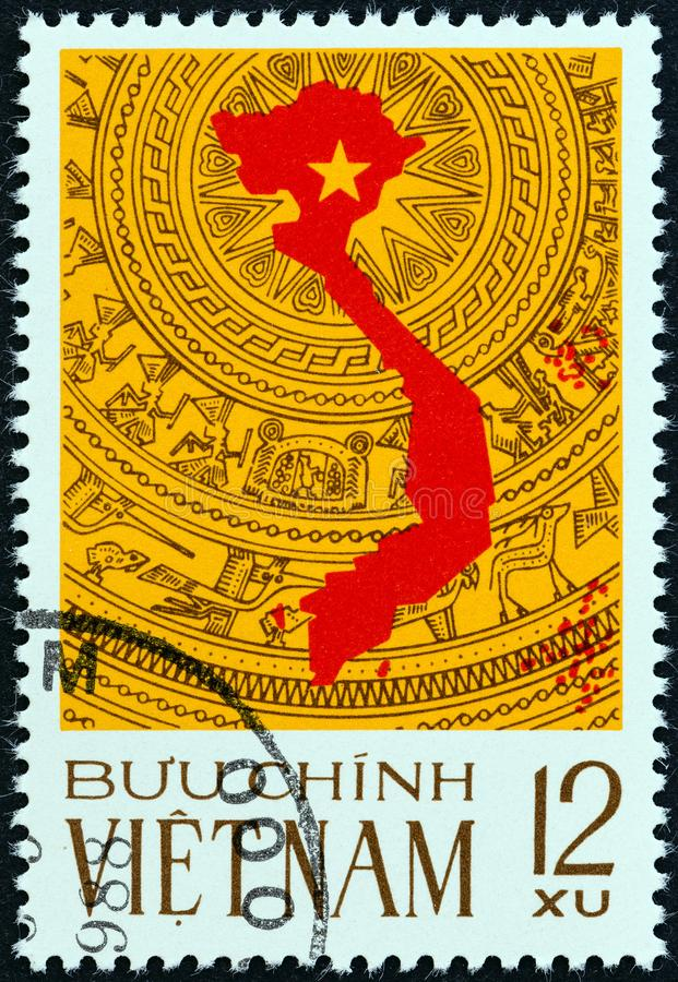 VIETNAM - CIRCA 1976: A stamp printed in Vietnam shows map on the bronze drum pattern symbol of the culture of Vietnam, circa 1976 royalty free stock images