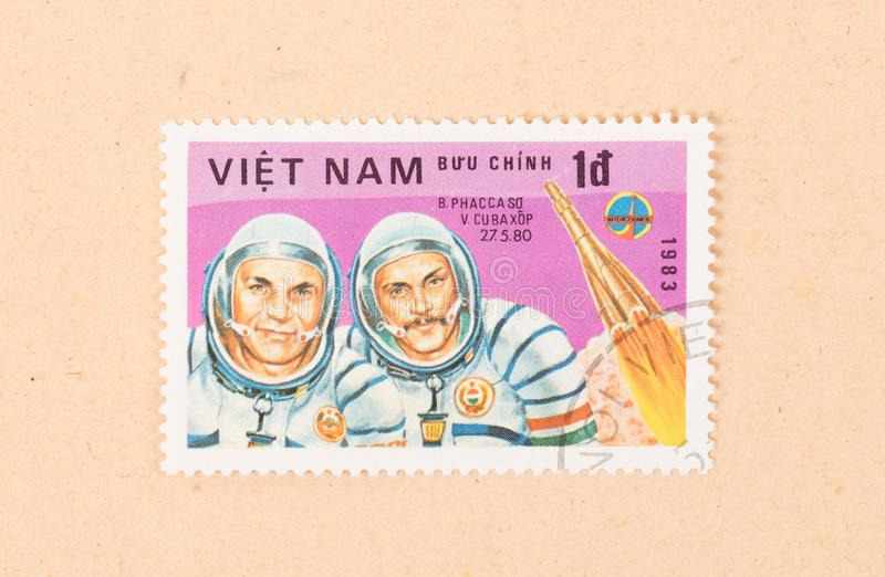 A stamp printed in Vietnam shows two cosmonauts, circa 1983. VIETNAM - CIRCA 1983: A stamp printed in Vietnam shows two cosmonauts, circa 1983 stock image
