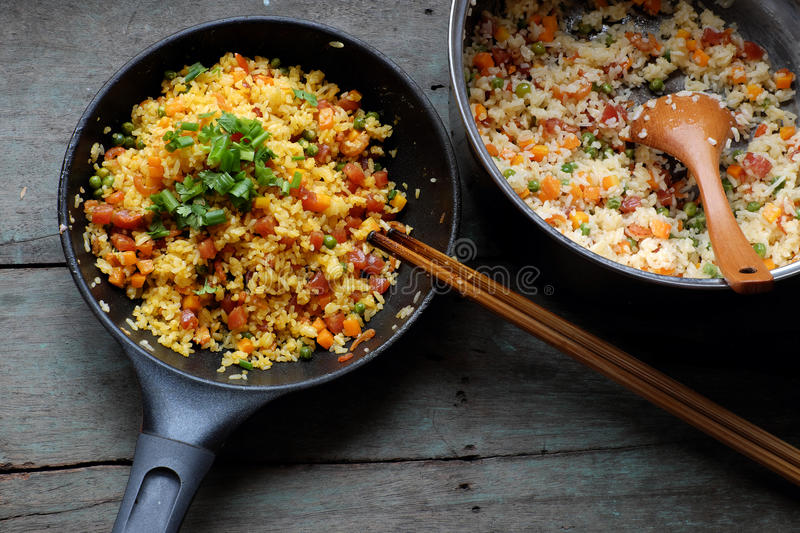 Vietnam food, fried rice. Make from rice, egg, sausage, dried shrimp, bean, cucumber, tomato, carrot and scallion, processing with colorful food material on royalty free stock photo