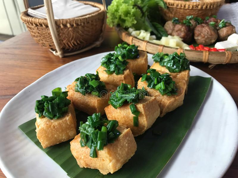 Vietnam food, tofu topped with stir fried Chinese Chive royalty free stock photo