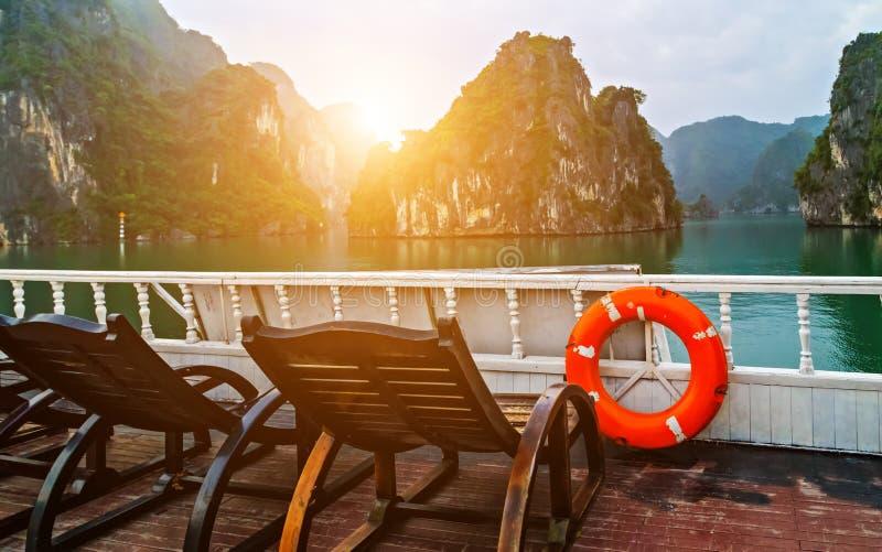 Vietnam, Ha Long Bay Cruse liner junk sails in sea landscape travel stock images