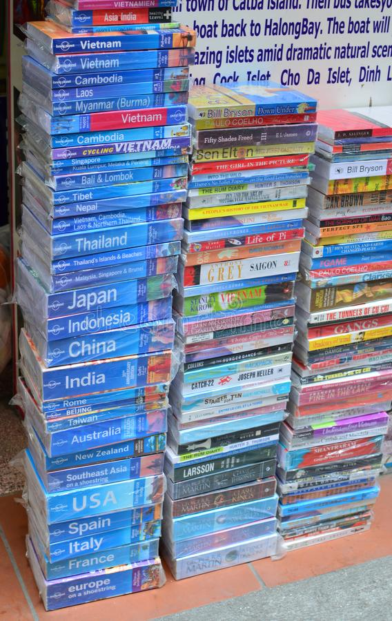 Vietnam - Hanoi - Travel shop - A pile of books stacked outside a travel agents. Lots of lonely planet guide books stock photo