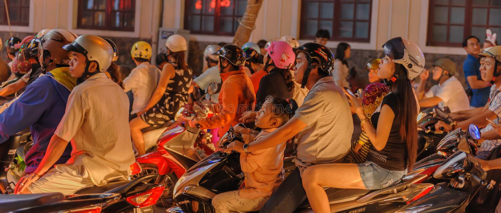 Vietnam - Ho Chi Minh City - Saigon. Hectic city traffic with local Vietnamese people on their motorbikes during the evening on the streets of Ho Chi Minh City royalty free stock photos
