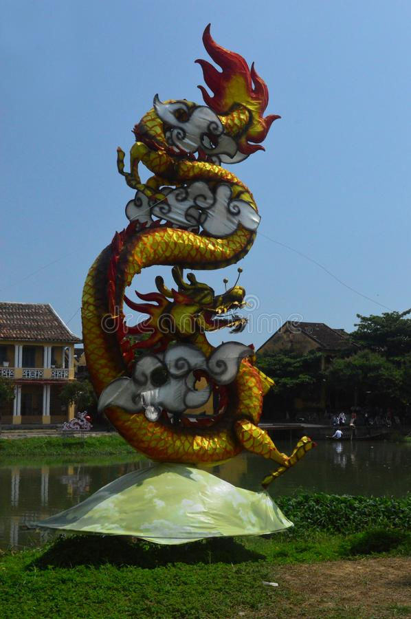 Vietnam - Hoi An - Dragon on the thu bon river. Vietnam - Hoi An- chinese style dragon lantern beside the Thu Bon river. Found in Quang Nam Province, this UNESCO stock photo