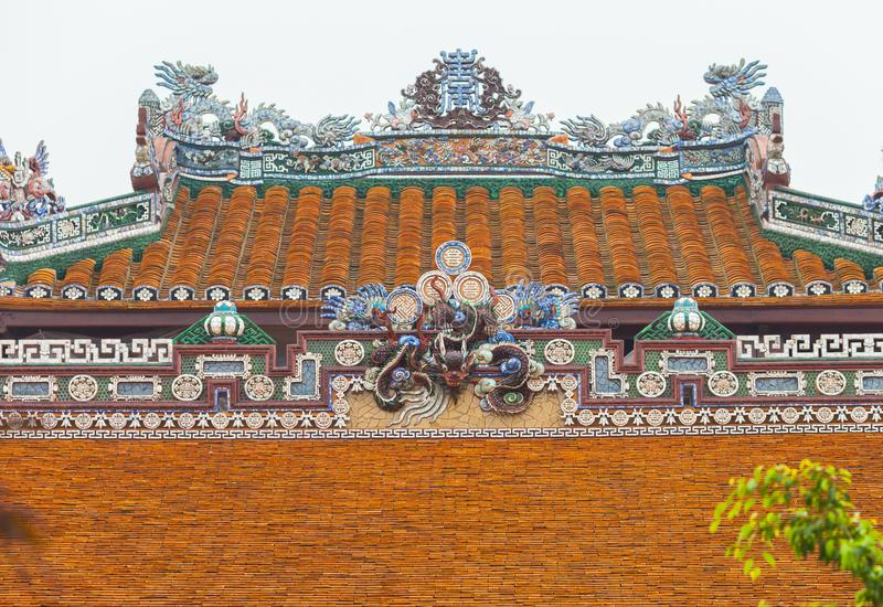 Vietnam, Hue. Roof tiles and decorative ornaments royalty free stock photo