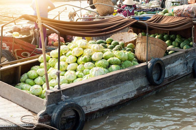 Vietnam, Mekong river delta. Boat on traditional floating market royalty free stock photos