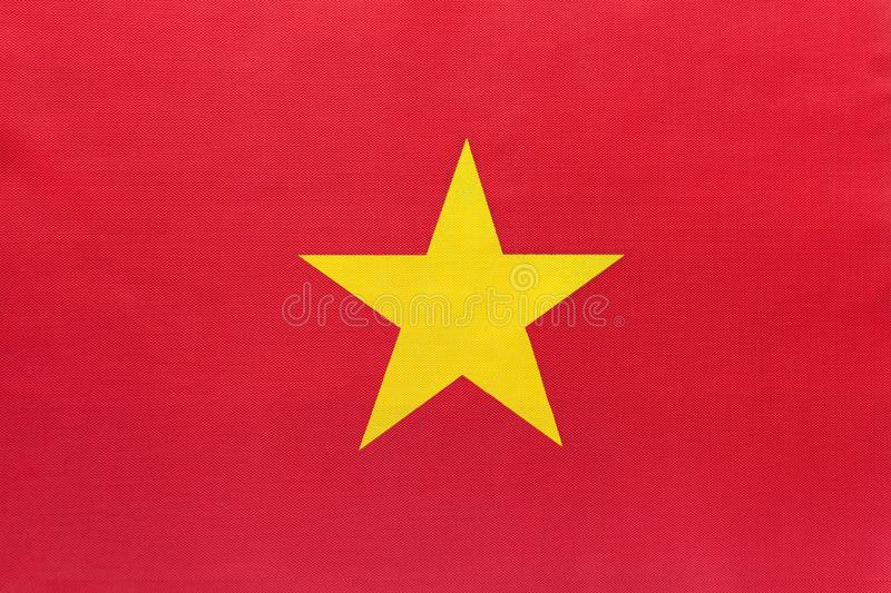 Vietnam national fabric flag with emblem, textile background. Symbol of international world Asian country. State official vietnamese sign stock image