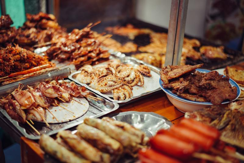 Vietnam street food. Shallow depth of field. Vietnam street food. Grilled meat, squid, octopus, shrimp on the street. Shallow depth of field royalty free stock photos