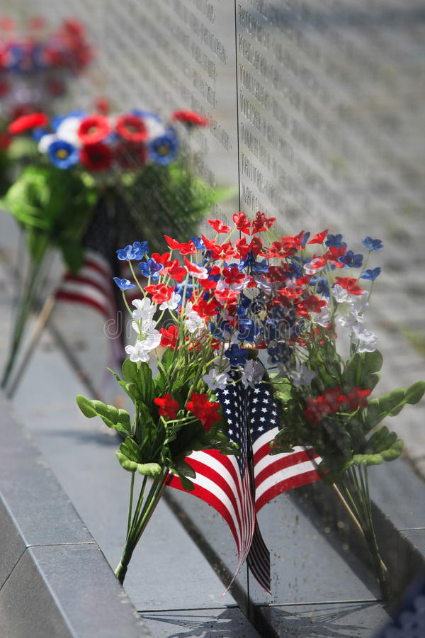 VIETNAM WALL MEOMORIAL FLAG AND FLOWERS
