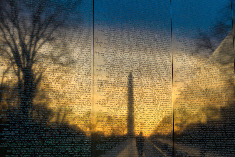 Vietnam War Memorial. With a reflection of Washington Monument at sunrise stock image