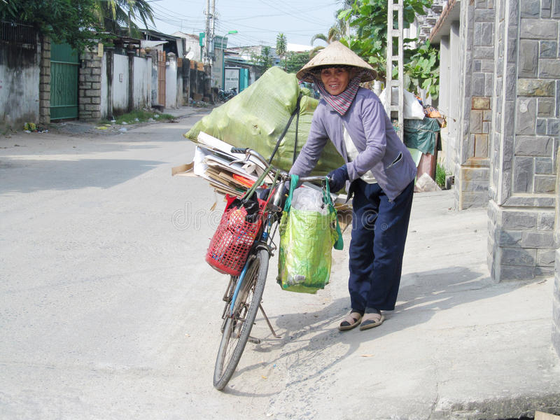 Vietnam woman with a bicycle royalty free stock photo