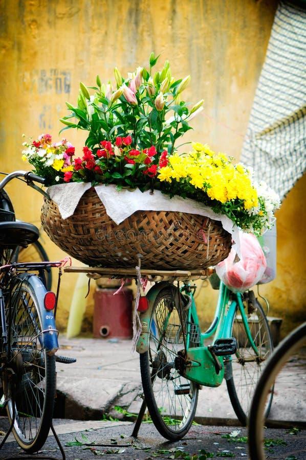 Vietname florist vendor in Hanoi. Vietnam farmer selling flower in small market in hanoi, vietnam stock photography