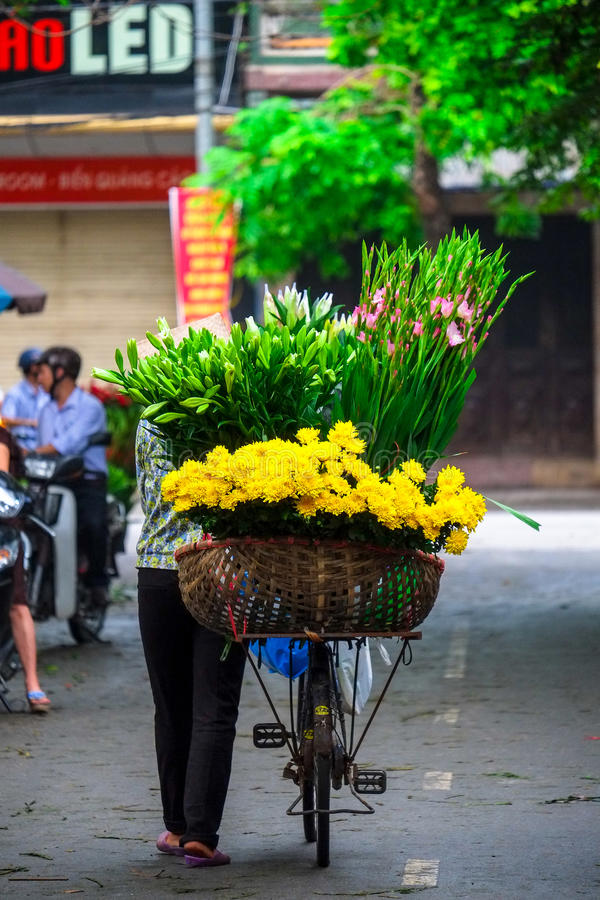 Vietname florist vendor in Hanoi. Vietnam farmer selling flower in small market in hanoi, vietnam royalty free stock image