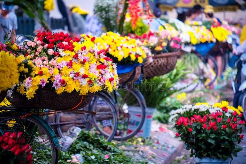 Vietname florist vendor in Hanoi. Vietnam farmer selling flower in small market in hanoi, vietnam royalty free stock photo