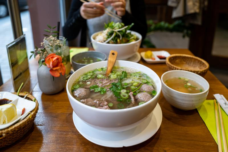 A vietname Pho soup in a restaurant.  royalty free stock images