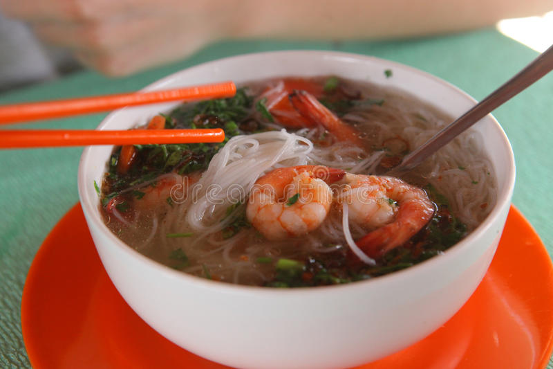 Vietnamese asian soup pho with noodle and shrimps. Close up photo royalty free stock image
