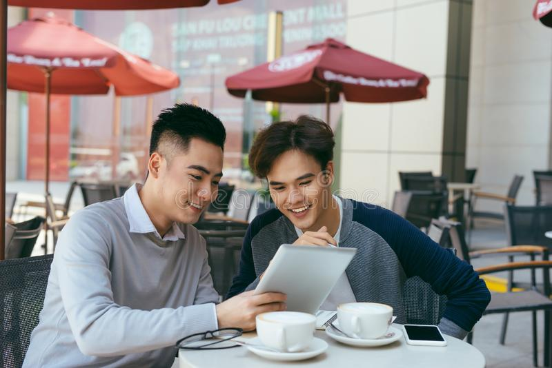 Vietnamese business partners chatting during the coffee break - Image stock image