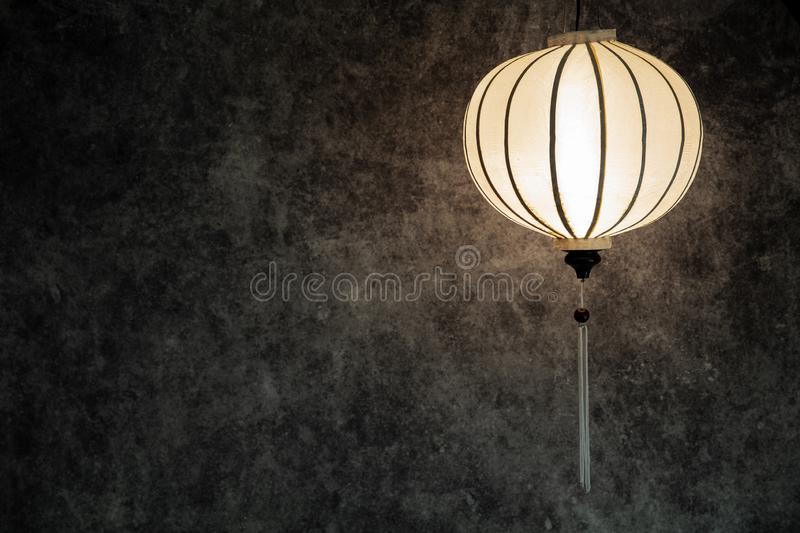 Vietnamese or Chinese white lantern spheric over vintage grunge concrete dark background with copy space in landscape orientation. Vietnamese or Chinese spheric stock illustration