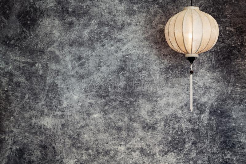 Vietnamese or Chinese white lantern, spheric shape over vintage grunge concrete background with copy space in landscape,. Vietnamese or Chinese white spheric royalty free illustration