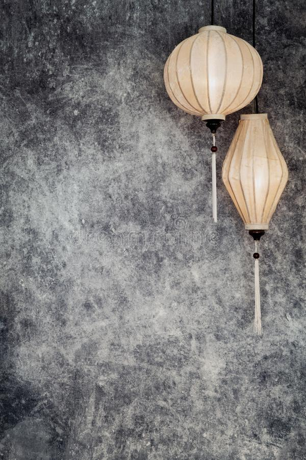 Vietnamese or Chinese white lanterns, spheric and oval over vintage grunge concrete background with copy space in landscape,. Two Vietnamese or Chinese white stock illustration
