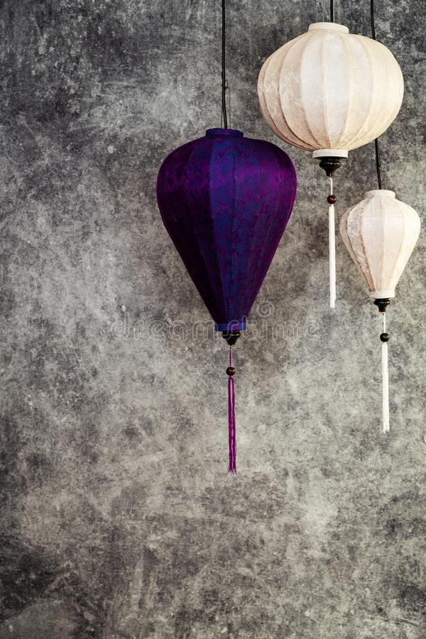 Vietnamese or Chinese white and purple lanterns, with light turned off, portrait orientation stock photography