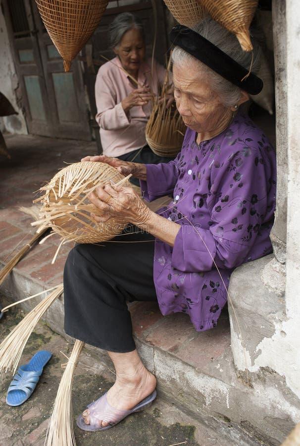 Vietnamese craftsmen making bamboo handicraft products. Hung Yen, Vietnam - Jul 26, 2015: Vietnamese craftsmen making bamboo handicraft products to maintain a stock photo